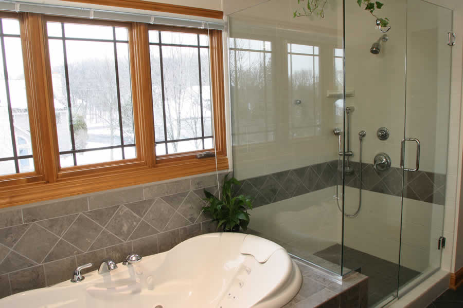 brookfield master bath with frameless shower and spa tub