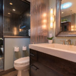 glass-shower-custom-vanity-privacy-panel-brown-tile-mirror-master-bath