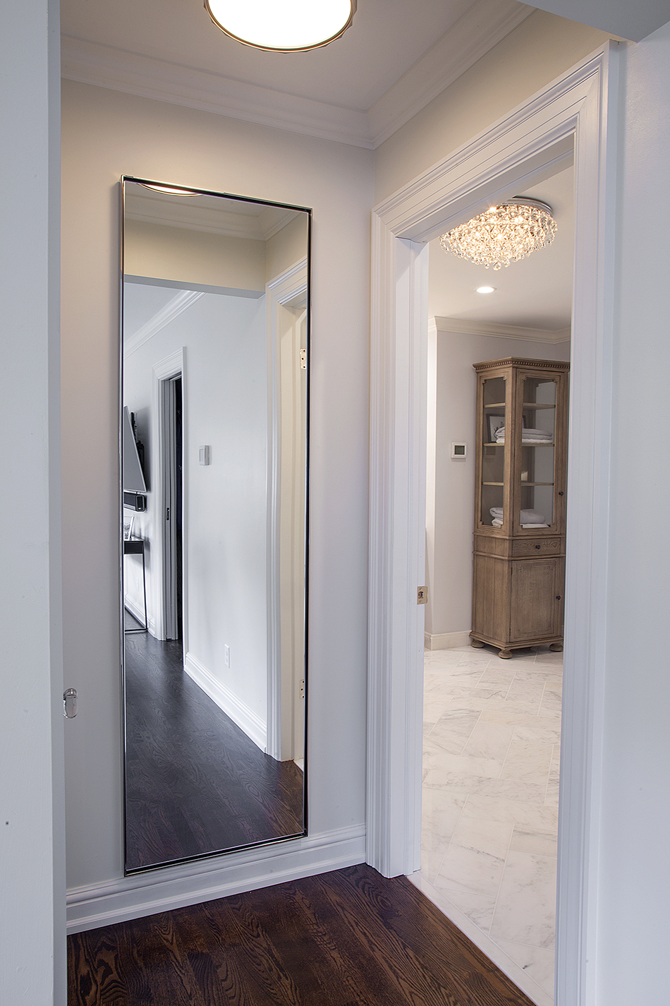 crown-molding-custom-hallway-mirror-wood-floor-whitefish-bay-wisconsin
