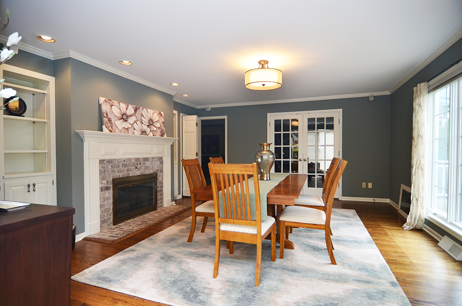 dining-room-refinished-hardwood-floors-brick-white-surround-fireplace