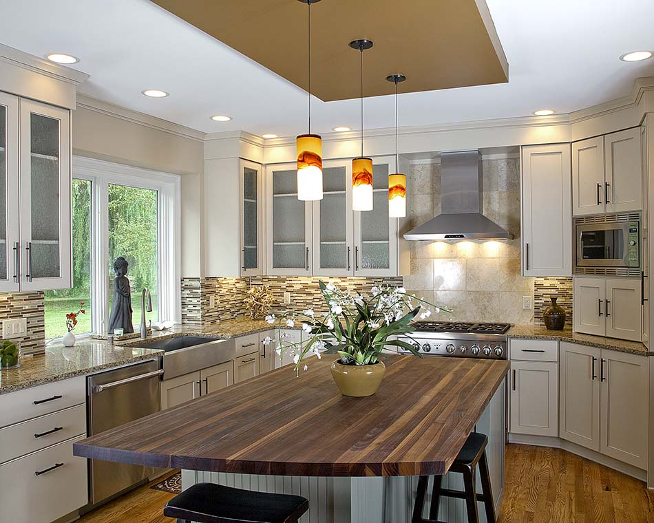 kitchen-remodel-butcherblock-island-cabinets-white-glass-inserts-granite-countertops-tile-backsplash