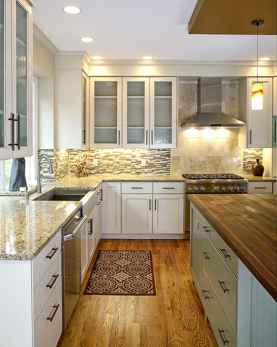 kitchen-remodel-granite-countertops-custom-cabinets-glass-incerts-stainless-steel-hood-whie-cabinets