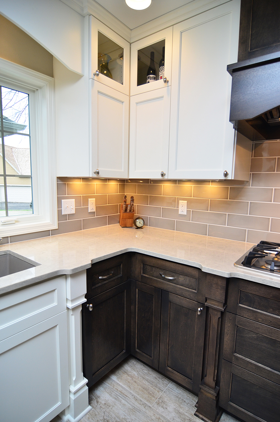 kitchen-two-tone-cabinets-sleek-white-countertops-brookfield