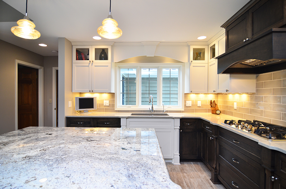 marble-counter-tops-under-cabinet-lights-custom-built-in-oven-hood