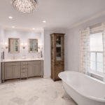 marble-floor-painted-vanity-chandelier-glass-knobs-master-suite-whitefish-bay