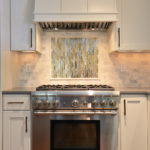 mounted-stove-top-Zephyr-hood-colorful-decorative-tile