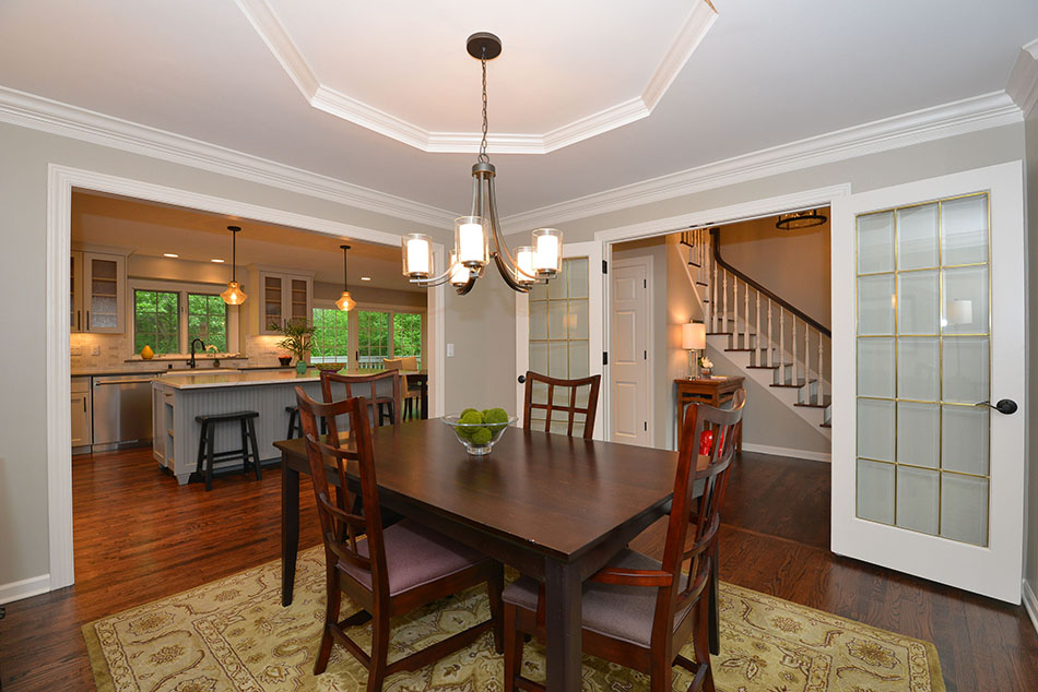 open-concept-dining-refinished-hardwood-floors-french-doors