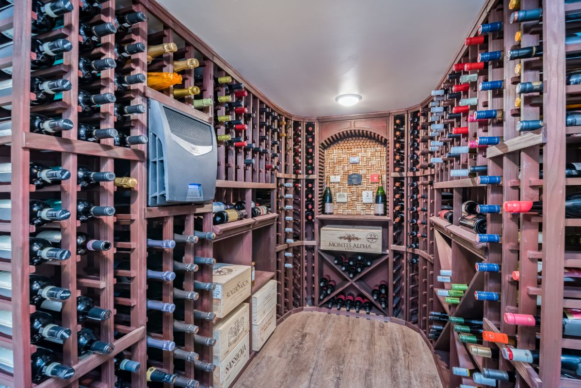 wine-cellar-corner-racks—LV-plank-floor-wine cellar-cooling-unit
