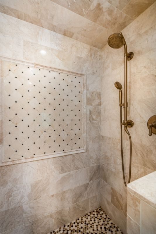 Kohler-air-induction-showerhead-queen-beige-shower-wall-marble-tile